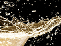 Detail of California Sparkling Wine splashing from glass